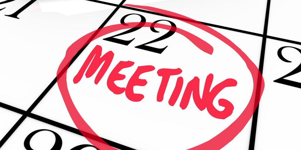 Meeting Word Circled on Calendar Red Marker